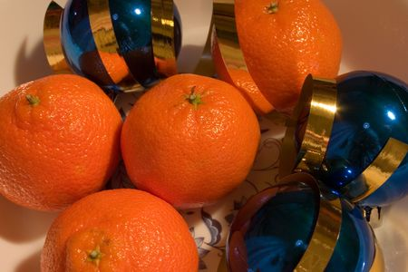 mandarins: Mandarins, blue ornaments and gold ribbon
