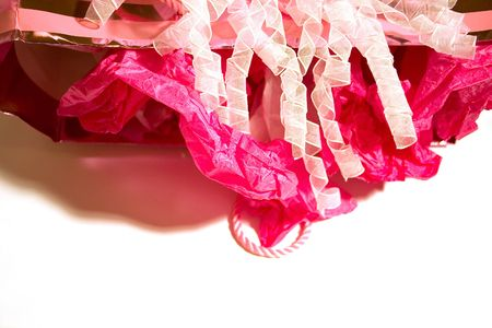 Used gift bag turned over with crushed tissue paper and ribbon spilling out to signify the party is over, isolated over white.