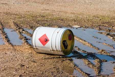 hazardous: Overturned can of industrial chemical.