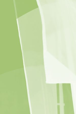 Several transparent banners or flags blowing in the breeze showing several layers and blends of pale green and white. photo