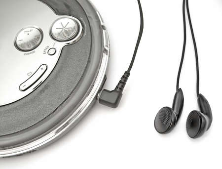 an mp3cd player with ear-buds plugged in Stock Photo