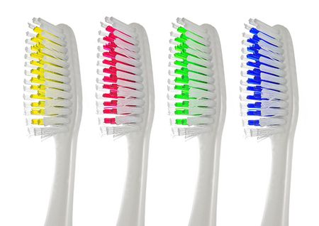 Closeup of a toothbrush isolated on white background. Stock Photo