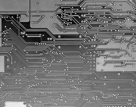 Detail of circuit board, solderings, paths.