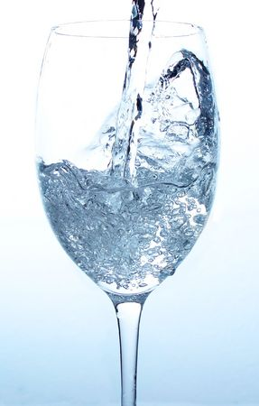 Water pouring on a glass, frozen in time Stock Photo