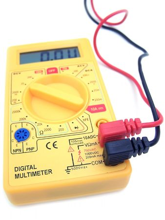A yellow multimeter with corresponding probes photo