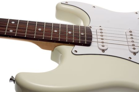 tune: Close up of the body and fretboard of a white electric guitar. Isolated on White.