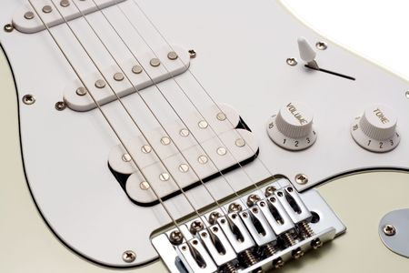 pickups: Close up of the pickups and bridge of a white electric guitar. Isolated on White. Stock Photo