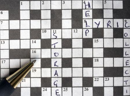 A pen on a crossword which has some clues solved. photo
