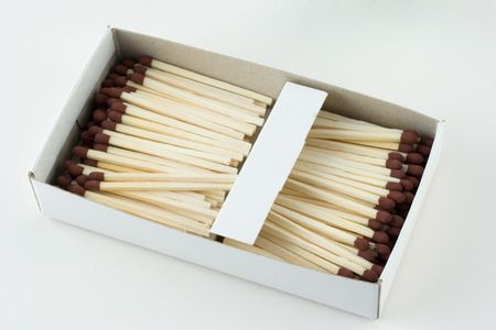 An open box of matches displaying its contents. photo