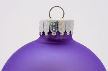 depicts: This image depicts a close up image of a purple Christmas decoration.