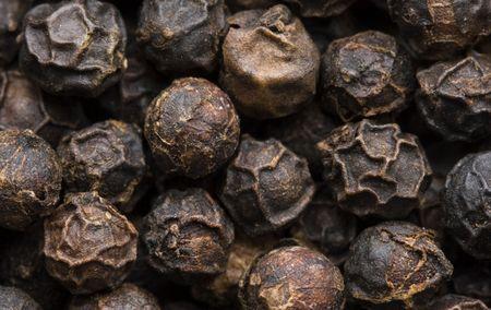 Macro image of peppercorns. photo