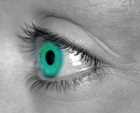 reverberation: Aqua eye against black and white skin Stock Photo