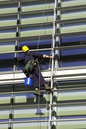 Workman Abseiling A Corporate Building Stock Photo - 2051044