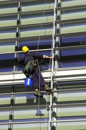 edificio corporativo: Workman rappel Un edificio corporativo
