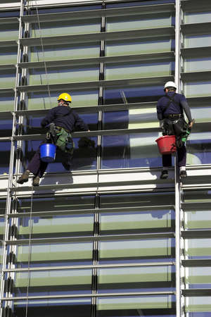 Workmen Abseiling A Corporate Building Stock Photo - 2051045