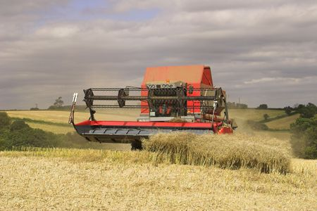 Combine harvester on Woodborough Park Farm, Woodborough, Nottingham, England, U.K.