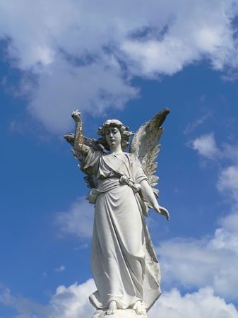 angel cemetery: Angel Descending (on a grave dated from the late 1800s) Stock Photo