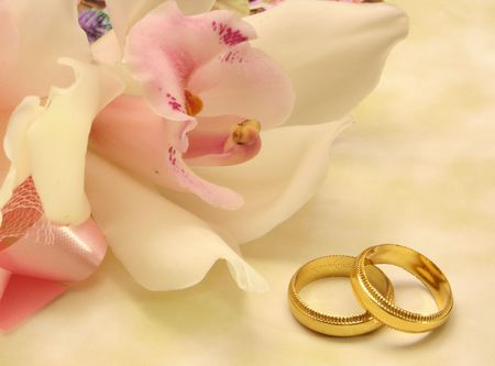 Orchid With Gold Wedding Bands, Close-up Stock Photo