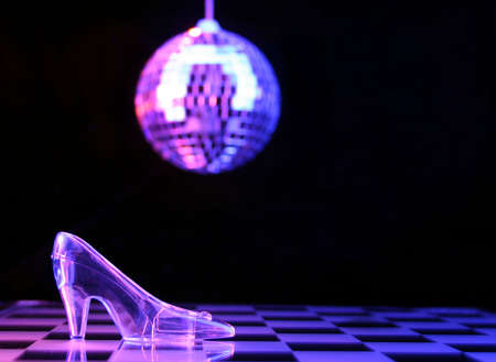 cinderella shoes: Glass Slipper With Disco Ball in Background,  Shallow DOF