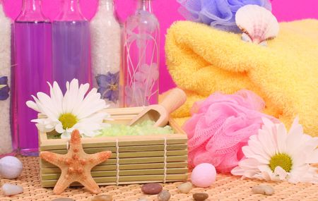 Bath Salts with Soap and Bubble Bath on Pink Background