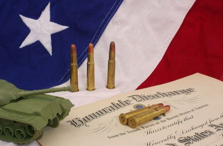 honorable: Honorable Discharge Certificate With Bullets and Plastic Army Tank on American Flag