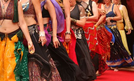 sexy girl dance: Row of Belly Dancers Preforming at a Festival