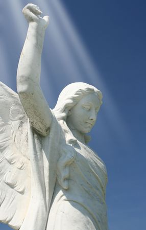 Angel Statue With Blue Sky and Light Beams