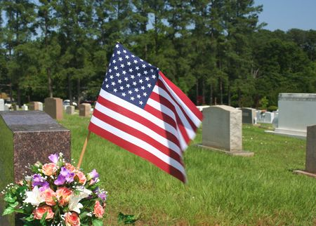 Flag and Flowers in Cemetery