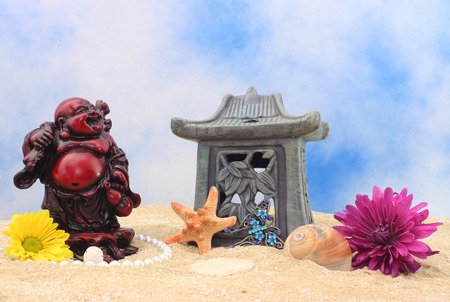 Still Life With Buddha, Flowers and Sea Shells on Beach Stock Photo - 1440015
