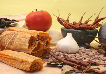Tamales with Peppers and Beans on Yellow Background