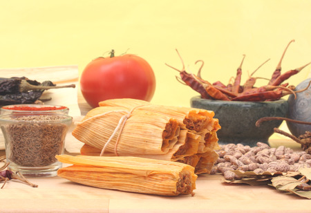 Tamales With Beans and Spices on Yellow Background Stock Photo