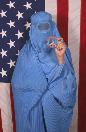 Woman From Afghanistan With Peace Sign and American Flag Stock Photo