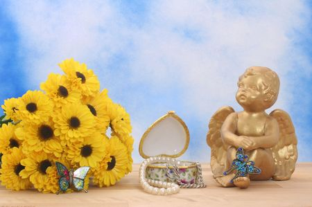 Flowers and Angel with Butterflies and J ewelry Box on Blue Sky Background Stock Photo - 2020044