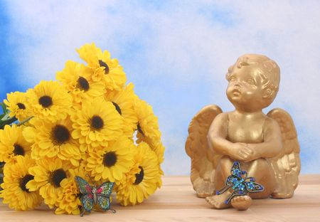 Flowers and Angel with Butterflies on Blue Sky Background photo