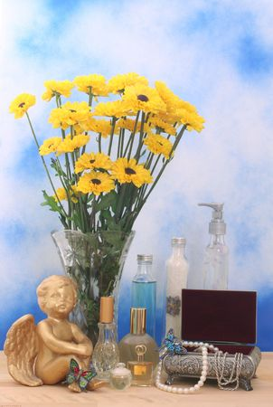 Flowers in Vase with Jewelry Box and Perfume on Blue Sky Background Stock Photo - 2020064