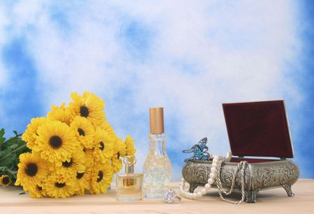 Jewelry Box With Perfume and Flowers With Blue Sky Background Stock Photo - 2020033