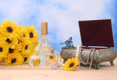 Jewelry Box With Perfume and Flowers With Blue Sky Background