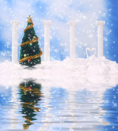 Christmas Tree and Swans on Snow With Blue Sky Background and water photo