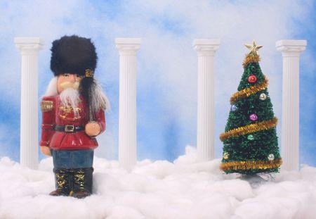 Nutcracker With Christmas Tree on Blue Sky Background photo