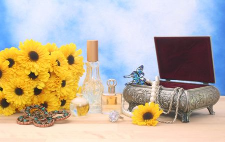 Jewelry and Perfume on Wood With Blue Sky Background Stock Photo - 2191873