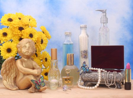 Jewelry and Perfume with Flowers and Angel on Blue and White Textured Background Stock Photo - 2196051