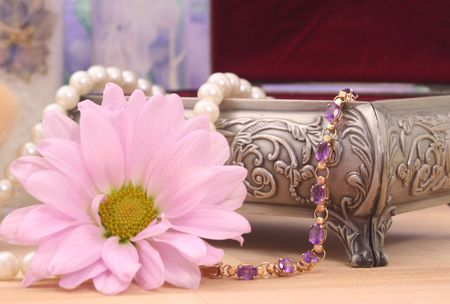 Gold and Amethyst Bracelet with Pink Flower and Antique Jewelry Box Stock Photo - 2283332