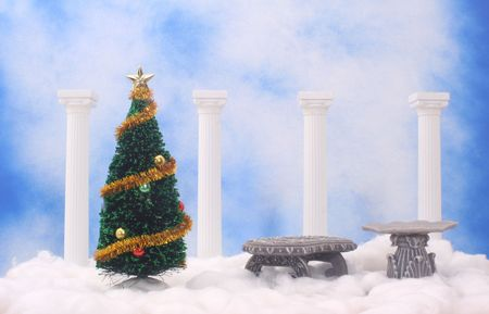 Christmas Tree and Columns on Cotton With Blue Textured Background photo