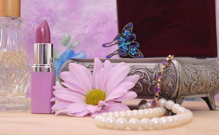 Cosmetics and Jewelry Box on Vanity With Floral Background photo