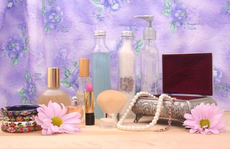 Cosmetics and Jewelry With Perfume on Table With  Floral Background, Shallow DOF Stock Photo - 2283360