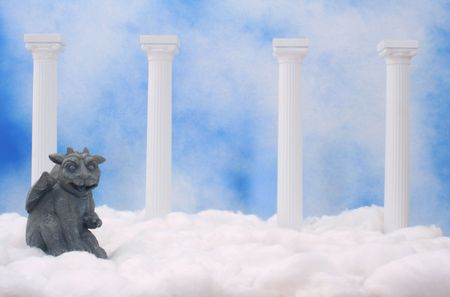 kingdom of heaven: Gargoyle With Columns and Clouds With Blue Textured Background