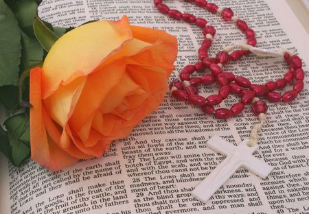 jesus rose: Rose With Rosary on open Bible