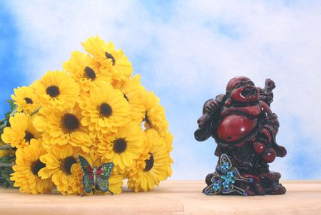 Flowers and Buddha Statue on Blue Textured Background Stock Photo - 2415351