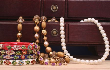 Vintage Jewelry and Open Jewelry Box on Table photo