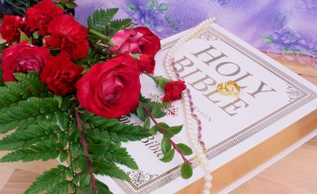 Roses With Bible and Wedding Rings on Wood Table Stock Photo - 2459298